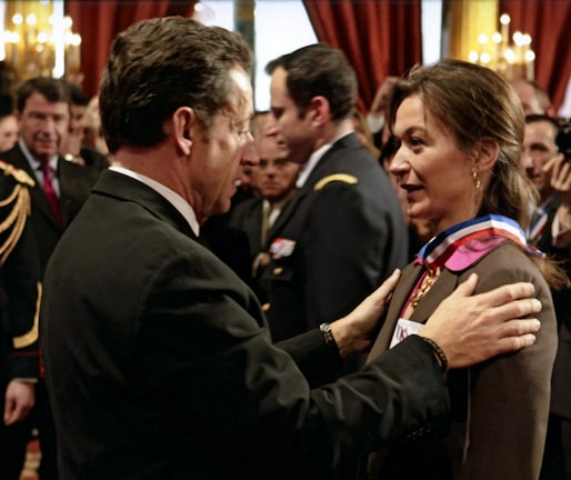 Sandrine Viollet receiving award from President Sarkozy