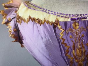 Straw embroidered Bodice center and sleeve detail showing embroidered straw, Photo courtesy The Straw Shop