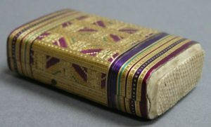 Straw match case vesta with striker, Courtesy Antiques Navigator