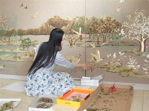 Chang Ai Ying infront of a section of Harmony of the World